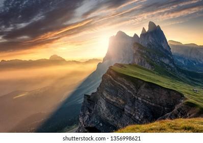 Breathtaking Alpine Highlands in Sunny Day. Impressively Beautiful Odle mountain range, Seceda peak in beautiful evening light at sunset. Wonderful view of world-famous Dolomites Alps, Amazing nature