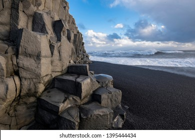 The breathtaking Basalt Columns at the Reynisfjara Black Sand beach in Iceland. Perfectly shaped symmetrical columns are truly magical creation of nature in truly surreal surroundings.
