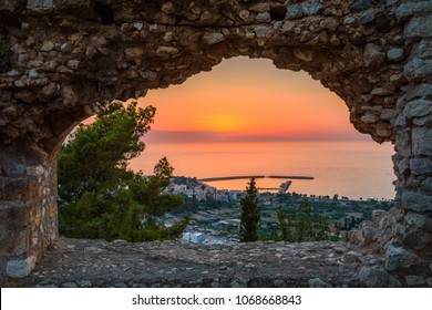 Breathtaking castle view over the picturesque coastal town of Kyparissia at sunset. Located in northwestern Messenia, Peloponnese, Greece, Europe.
