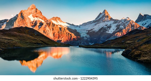 Breathtaking evening panorama of Bachalp lake/Bachalpsee, Switzerland. Exciting autumn sunset in Swiss alps, Grindelwald, Bernese Oberland, Europe. Beauty of nature concept background. - Shutterstock ID 1222904395