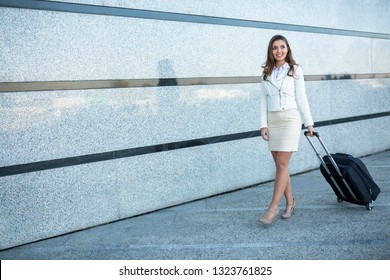 Breathtaking girl dressed in fancy clothes walking with style and glamour