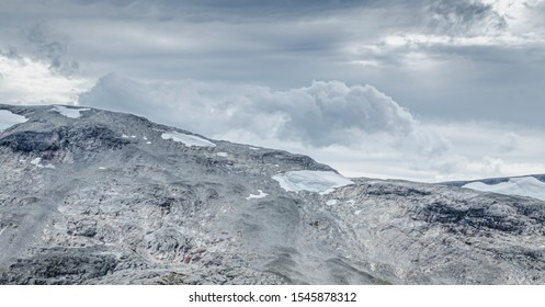 Breathtaking  icy view to mountains landscape and surroundings from Dalsnibba viewpoint in Norway near Geirangerfjord