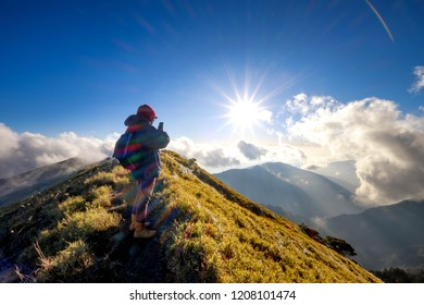 A breathtaking landscape in Taiwan. This was taken on top of a mountain. The clouds formation is vast and dramatic. The sun rises above the thick clouds. The image is calm, peaceful and magnificent.