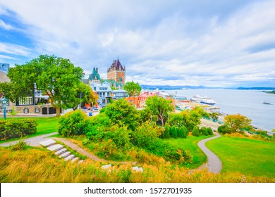 Breathtaking landscape view of Quebec City against St Lawrence river and blue cloudy sky in summer, from top hill. Skyline scene of old port in Quebec, Canada. Outdoor, Travel, Transportation Concept.