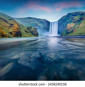 Breathtaking morning view of Skogafoss Waterfall. Astonishing summer sunrise on Skoga river. Moody outdoor scene of Iceland, Europe. Beauty of nature concept background.