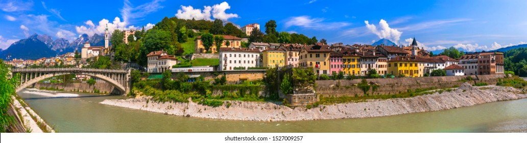 Breathtaking panorama of beautiful Belluno town surrounded by Dolomite mountains
