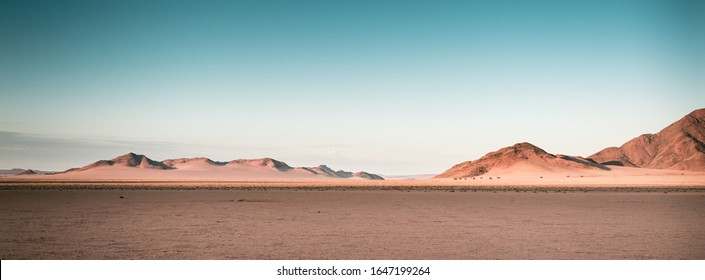 a breathtaking panoramic shot of desert plains in Namibia Africa with hills in the background - Shutterstock ID 1647199264