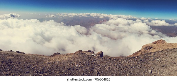 Breathtaking panoramic view from Damavand mountain, the highest volcano in Iran (5671 m). Sunny weather, cloudy sky and rocky mountains in Iran
