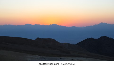 Breathtaking Panoramic view of Mount Salomon 'Har Shelomo' (Hebrew) in Eilat Mountains at sunrise, the Arava valley & Mountains silhouette of Edom Granite Mountains in Jordan as seen from Israel