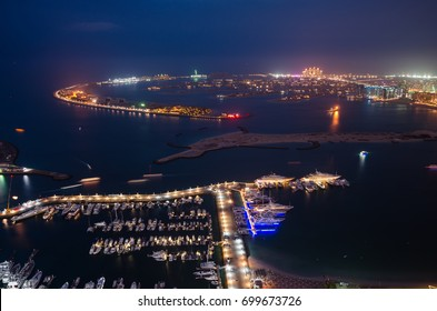 A breathtaking panoramic view of the Palm Jumeirah at night from a height, Dubai, United Arab Emirates