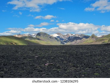 Breathtaking scene of Hvanngil valley and multi-colored rhyolite mountains on the background in sunny day with blue sky, Laugavegur Trail between Emstrur Botnar and Alftavatn, Highland of Iceland
