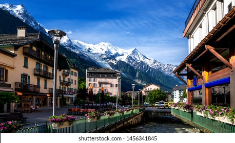 Breathtaking scenery of the Alps from Chamonix France. Chamonix downtown in summer. Beautiful buildings on a sunny day of summer. River, flowers, colorful facades.