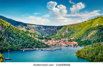 Breathtaking spring cityscape of Skradin port. Aerial morning vire of Krka National Park, Prokljansko lake, Croatia, Europe. Beautiful world of Mediterranean countries. Traveling concept background.