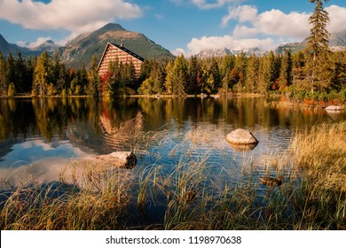 Breathtaking Strbske mountain lake with its reflections on sunset in Autumn, High Tatras in the background