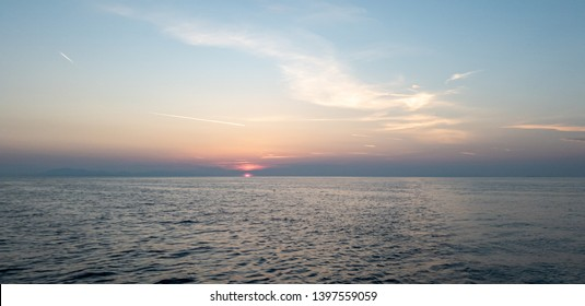 Breathtaking sunrise with amazing red and yellow colors on the Adriatic sea, close to Dubrovnik, on a sailing yacht at the coast of the national park of Mljet, croatia