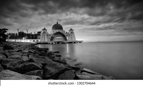 Breathtaking Sunrise in black and white at Straits Mosque of Malacca, Malaysia.The Mosque is floated and built at man made Island, Malacca, Malaysia.