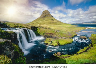 Breathtaking sunrise over Kirkjufell mountain landscape and waterfall in Iceland summer. Kirjufell is the beautiful landmark and the most photographed mountain which attracts tourist to visit Iceland.