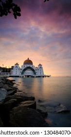 Breathtaking Sunrise at Straits Mosque of Malacca, Malaysia.The Mosque is floated and built at man made Island, Malacca, Malaysia.
