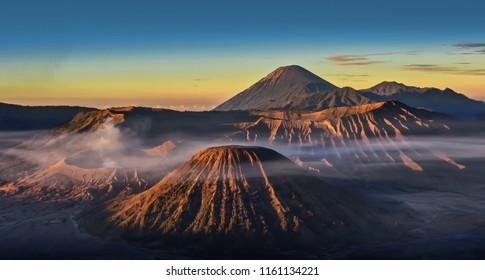 Breathtaking sunrise view of Volcanos at Bromo, consisting of Active Bromo, Mount Batok and Mount Semeru. beautiful landscape landmark and popular destinations in indonesia