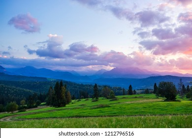 Breathtaking sunset at Belianske Tatras mountains during blue hour with last rays of sunlight.