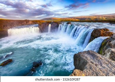 Breathtaking sunset landscape scene of powerful Godafoss waterfall. Dramatic sky over Godafoss. Location: Bardardalur valley, Skjalfandafljot river, Iceland, Europe