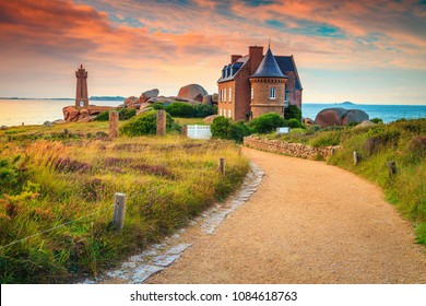 Breathtaking sunset with lighthouse and luxury villa, Ploumanach Mean Ruz in Perros-Guirec on Pink Granite Coast, Brittany, France, Europe