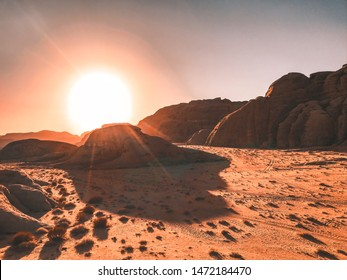 Breathtaking sunset in Wadi Rum in Jordan. Wadi Rum is known as The Valley of the Moon and has led to its designation as a UNESCO World Heritage Site.