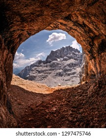 Breathtaking view from cave entrance in Italian Dolomites.