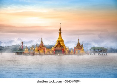 A breathtaking view to the Floating Pagoda Shwe Myitzu in fog at sunrise. Indawgyi Lake Wildlife Sanctuary, one of the largest inland lakes in Southeast Asia. Kachin State, Myanmar