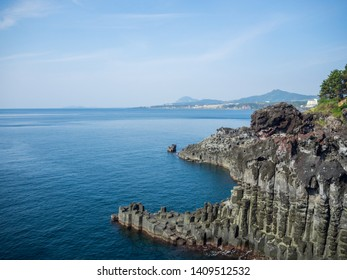 Breathtaking view of the Jungmun Daepo Haen Columnar (Jusangjeolli cliff) was formed due to the sudden cooling of lava from the Hallasan Mountain at Jeju island, South Korea