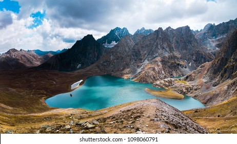 The breathtaking view of Krishansar lake in dry season under a cloudy weather from Gadsar Pass (4,080m), Kashmir The Great Lakes Trek, India.