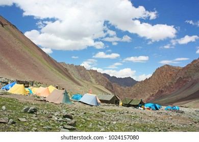 Breathtaking view of Mankorma Camp with beautiful sky, clouds background and Himalayan mountains in Ladakh, India. Indian Tibet region in Jammu and Kashmir, northern India. Trek to Stok kangri summit.