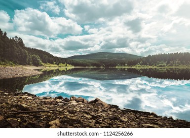 Breathtaking view of a mountain lake in front of the Brocken, Harz, Germany