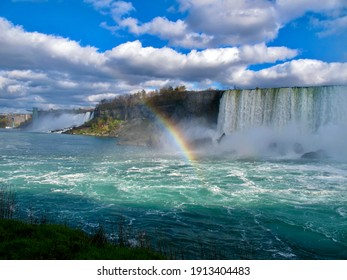 Breathtaking view of Niagara Waterfall in Toronto Canada with clouds on top, Waterfall, Rainbow, reflection of sun in the water.