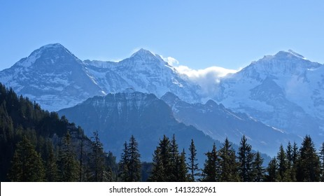 breathtaking view on swiss alps mountains (Eiger, Moench, Jungfrau peaks from left to right) from Schynige Platte Panorama hike, Jungfrau region, Bernese Highlands (close to Bern), Switzerland, Europe