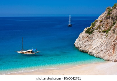 Breathtaking view over the lonely Kaputas beach and arriving tourist boats. Antalya region, Turkey