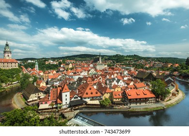 A breathtaking view over the old Town of Cesky Krumlov on river Vltava under the beautiful cloudy sky. Czech Republic. Europe . UNESCO World Heritage