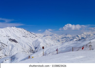 A breathtaking view of snows on the mountains of Alborz. north of Tehran. damavand mountain peak. Dizin Pist