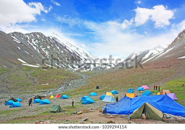 Breathtaking view of Stok Kangri Base Camp with beautiful sky, clouds background and Himalayan mountains in Ladakh, India. Region in Jammu and Kashmir, northern India. Lifestyle adventure concept.