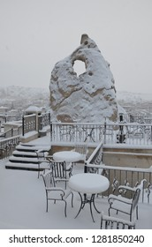Breathtaking view of Valley in winter season, Cappadocia national park, Turkey with a special rock and sitting space. Heavy snow fall during christmas time.