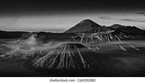 Breathtaking view of Volcanos at Bromo, consisting of Active Bromo, Mount Batok and Mount Semeru. beautiful landscape landmark and popular destinations in indonesia. black and white photograpy