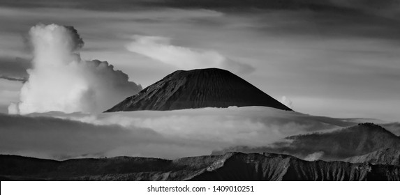 Breathtaking view of Volcanos at Bromo, consisting of Active Bromo, Mount Batok and Mount Semeru. beautiful landscape landmark  black and white photograpy . soft  and grain effect.