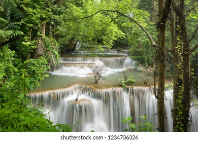 Breathtaking waterfall at deep forest, Tropical rain firest or evergreen forest with waterfall, Erawan waterfall located Kanchanaburi Province, Thailand