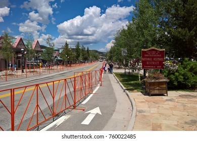 BRECKENRIDGE, CO - JULY 4, 2016: View down Main Street after the annual 4th of July Parade in 2016.  A welcome sign denotes the Town of Breckenridge`s status as a National Historic District.