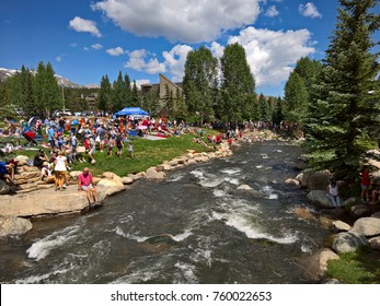 BRECKENRIDGE, CO - JULY 4, 2016: Vacationers relax along the Blue River at Breckenridge`s Riverwalk Center on July 4, 2016.