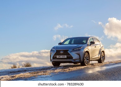 Brecon Beacons, UK: December 28, 2017: A Lexus NX 300h F-Sport crossover hybrid car on the road side in snow and dangerous icy conditions with copy space.