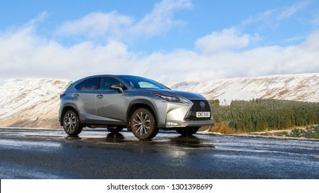 Brecon Beacons, UK: January 30, 2019: A Lexus NX 300h F-Sport crossover hybrid car on the road side in snow and dangerous icy conditions.