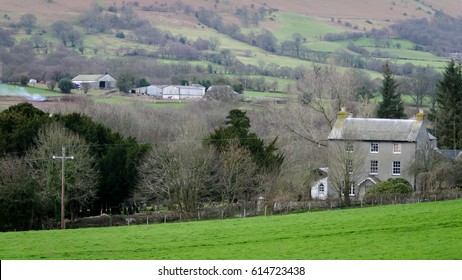 BRECON BEACONS, WALES - 14 FEBRUARY 2005: A traditional Welsh farm house and valley with barns visible in the distance.