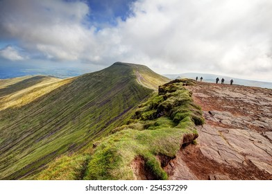 BRECON, WALES - SEPTEMBER 07, 2014 : People walking towards the peak of Pen y Fan from the top of Corn Du in the Brecon Beacons.