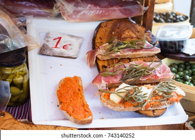 Bred with olive oil (pa amb oli) with jamon, sobrasada and Majorcan herbs for sale at Sineu market, Majorca, Spain